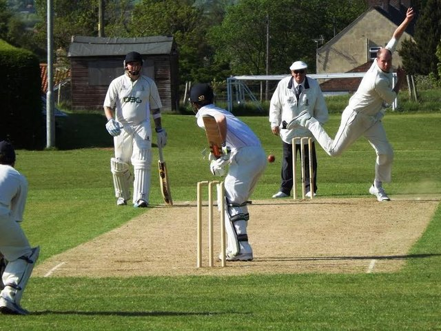 Tom Bumby, above in bowling action, hit 27 in Heslerton's win
