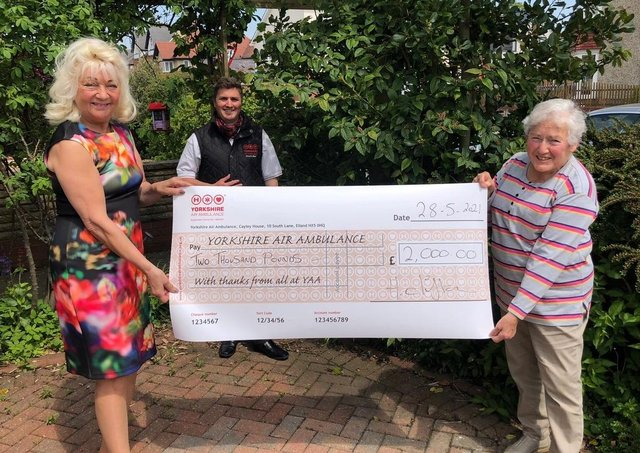YAA representative Keiron Hardwick is presented with the cheque for £2,000 by Helen Clifton and Barbara Ratcliffe.