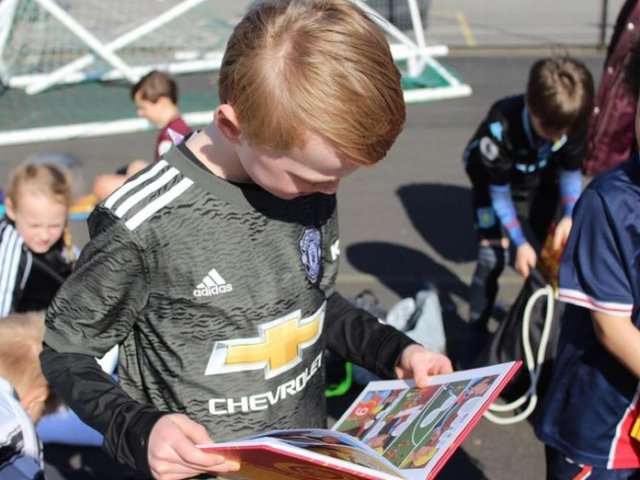 Robbie Hawkes has gifted over 500 Roy of the Rovers books to those attending his football sessions
