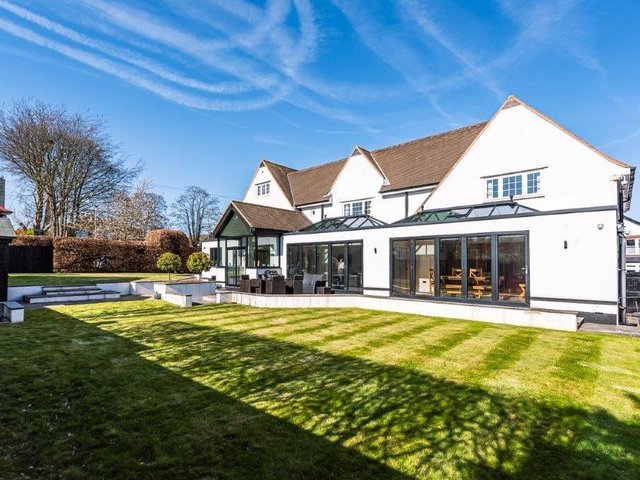 Stretch of lawn within the gardens of the impressive Scalby home