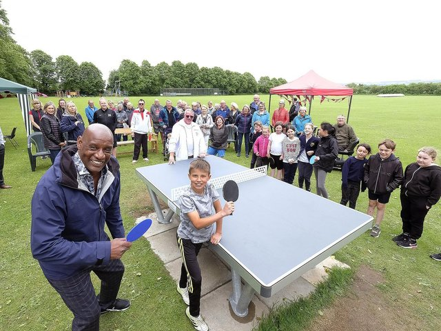The Chase star Shaun Wallace opens the new outdoor table tennis table at Snainton  Photo by Richard Ponter