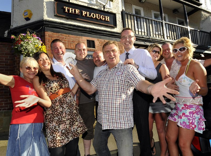 Clive Welburn, centre, Scalby's Got Talent winner presents £200 to St Catherine's Hospice director of  fundraising David Marshall, centre right, watched by his friends and fans at The Plough.