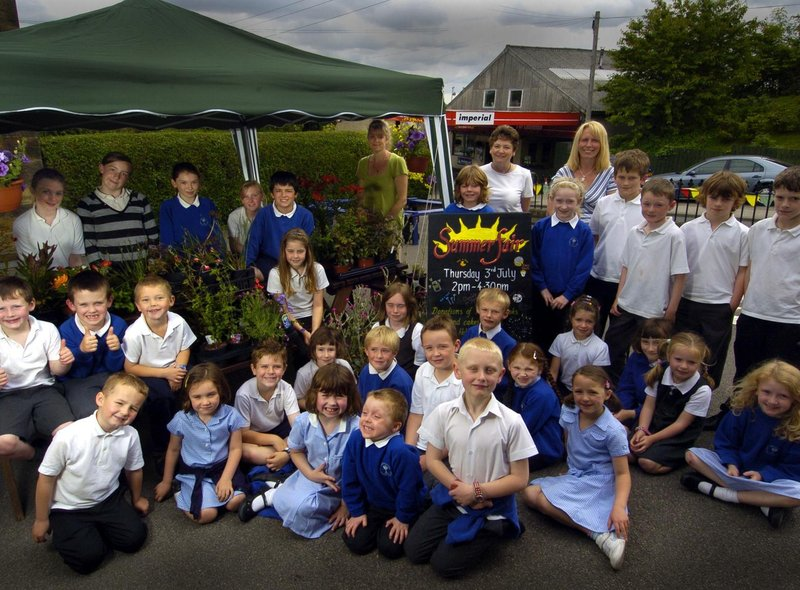 Castleton Primary School staff and pupils prepare for their summer fair.