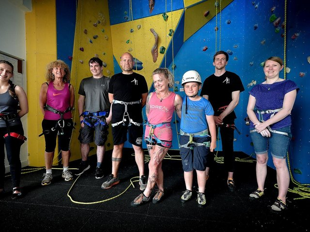 David Scriver, fourth from left, and club colleagues at The Street's climbing wall.