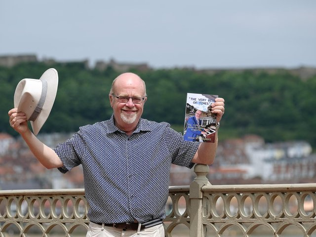 Howard Beaumont with his new book