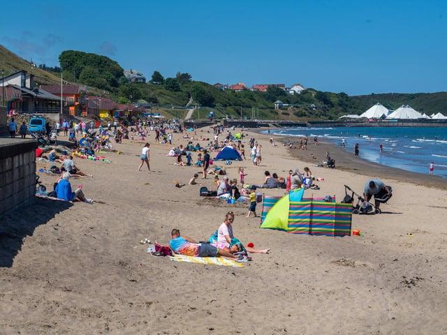 Beach-goers enjoy Scarborough's North Bay in June 2020.