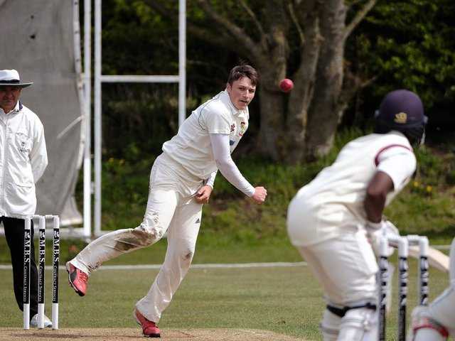 Elliot Hatton, in bowling action, top-scored with the bat for Flixton