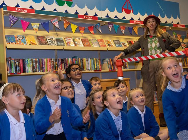 Children and the Professor watch with delight as Time Traveller arrives